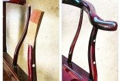 A oriental rosewood chair with top of the arm support snapped off and missing