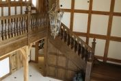 Oak Staircase with panelled understair cupboard